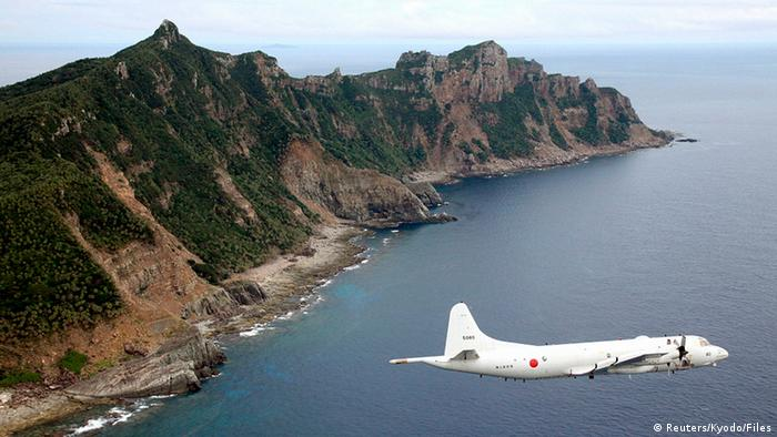 Japan Maritime Self-Defense Force's PC3 surveillance plane flies around the disputed islands in the East China Sea, known as the Senkaku isles in Japan and Diaoyu in China, in this October 13, 2011 file photo. Japan on July 31, 2012 flagged the Chinese army's growing role in shaping the country's foreign policy as a security risk, saying a sense of caution exists across East Asia about Beijing's apparent military expansion in the region. Picture taken October 13, 2011. MANDATORY CREDIT. REUTERS/Kyodo/Files (JAPAN - Tags: POLITICS MILITARY) FOR EDITORIAL USE ONLY. NOT FOR SALE FOR MARKETING OR ADVERTISING CAMPAIGNS. THIS IMAGE HAS BEEN SUPPLIED BY A THIRD PARTY. IT IS DISTRIBUTED, EXACTLY AS RECEIVED BY REUTERS, AS A SERVICE TO CLIENTS. MANDATORY CREDIT. JAPAN OUT. NO COMMERCIAL OR EDITORIAL SALES IN JAPAN. YES