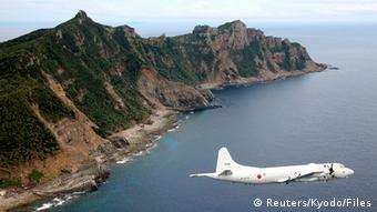 Japan Maritime Self-Defense Force plane flies over an island