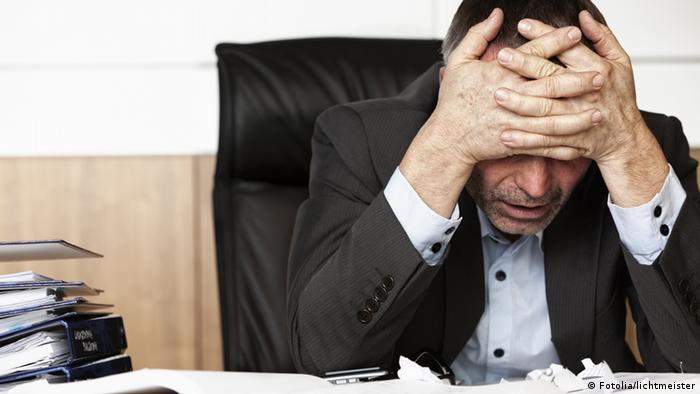 Frustrated office manager overloaded with work