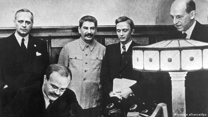 Joachim von Ribbentrop and Vyacheslav Molotov with other officials at the pact signing ceremony