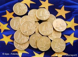 Euro coins on an EU flag