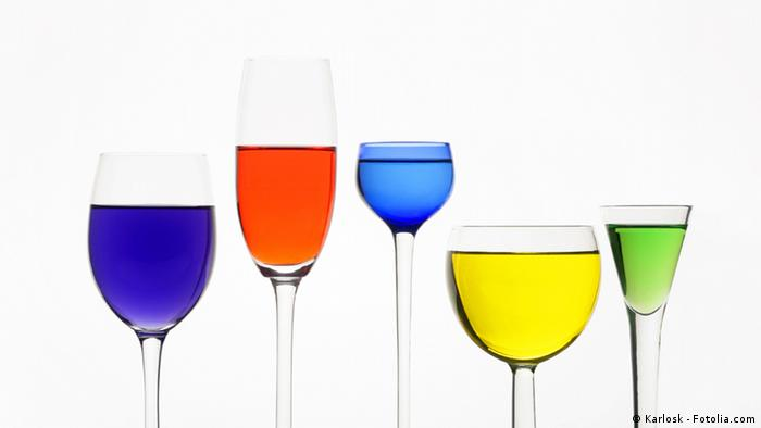 Various differently shaped wine glases with liquid in various colors(Karlosk - Fotolia.com)