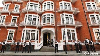 Police gather outside the Ecuador embassy in west London, August 16, 2012.