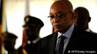 South African President President Jacob Zuma with security guards in background. Photo by STEPHANE DE SAKUTIN/AFP/GettyImages)