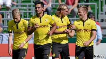 Dortmund's Marco Reus, 2nd from left, is celebrated after scoring during the German soccer cup match between FC Oberneuland and Borussia Dortmund in Bremen, Saturday, Aug. 18, 2012. (AP)