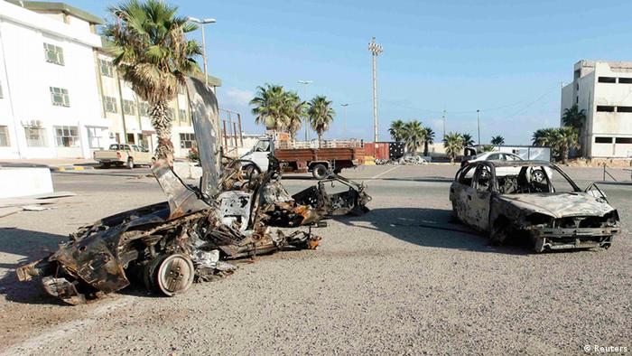 Damaged cars are pictured after an explosion near a women's police academy in Tripoli, August 19, 2012. Two explosions struck the Libyan capital of Tripoli on Sunday, one near the Interior Ministry and the second near a women's police academy, a Libyan security officer told a Reuters photographer. REUTERS/Ismail Zitouny (LIBYA - Tags: CIVIL UNREST)