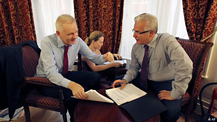 WikiLeaks founder Julian Assange, left, talks with his legal adviser Balthasar Garcon, right, while they sit inside the Ecuadorian embassy in London, Sunday Aug. 19, 2012. WikiLeaks founder Julian Assange took refuge inside Ecuador's Embassy in London two months ago, seeking to avoid extradition to Sweden for questioning over sexual misconduct allegations. (AP Photo / Sean Dempsey, PA) UNITED KINGDOM OUT - NO SALES - NO ARCHIVE.