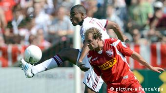 Christoph Beismann (r) of Havelse and Marcos Antonio Elias Santos of Nuremberg fight for the ball