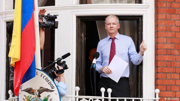 WikiLeaks founder Julian Assange gives a thumbs up sign after speaking to the media outside the Ecuador embassy in west London (photo: REUTERS/Olivia Harris)
