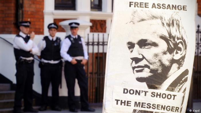 A pro-Assange placard is seen outside the Embassy of Ecuador, in central London, Saturday August 18, 2012, (AP Photo / Dominic Lipinski/PA)