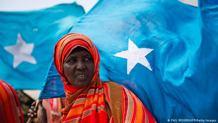 A Somali woman watches the inauguration ceremony of the new Somali President Abdullahi Yusuf Ahmed, Thursday, Oct. 14, 2004 in the Kenyan capital Nairobi.