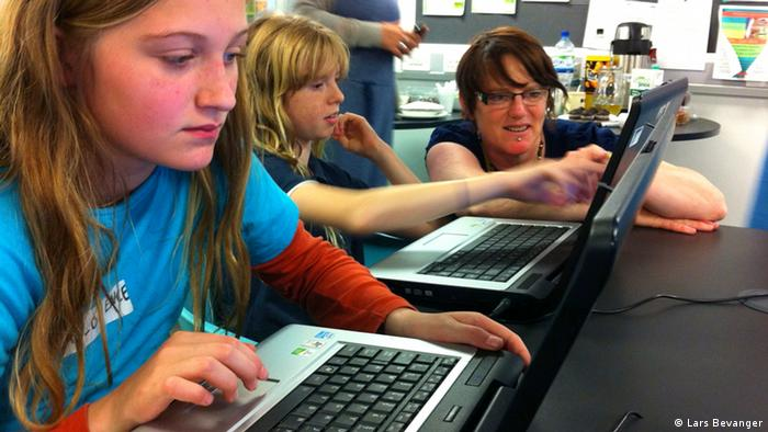 Two girls being instructed at a Manchester Girl Geek session