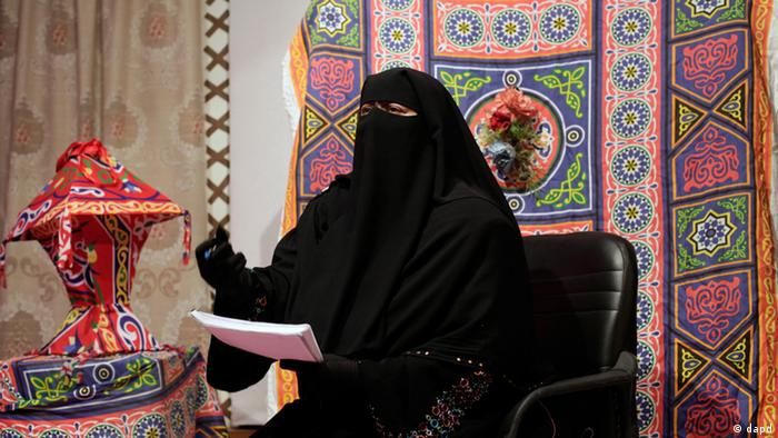 Nahla Hashad, a presenter at the Maria Channel, speaks during a segment of a Ramadan program (Photo:Maya Alleruzzo/AP/dapd)