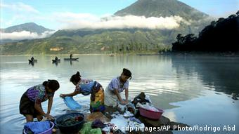 Indigenous women wash laundry along the shores of Lake Atitlán