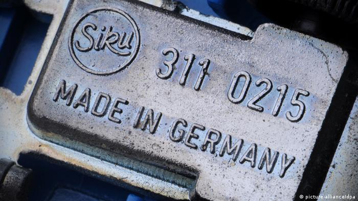 The belly of a toy car with the 'Made in Germany' label