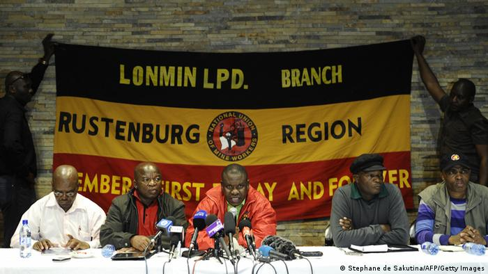 NUM officials speak at a Congress of South African Trade Unions (COSATU) press conference in Marikana. Clashes erupted on August 16 and in previous days at the Marikana platinum mine, with clashes between striking workers asking for wage increases and police having left 44 people dead. Lonmin, the world's third-largest platinum miner, said workers on a wildcat strike who fail to report for duty on August 21 could be fired. The National Union of Mineworkers, whose clash with the rival upstart Association of Mineworkers and Construction Union precipitated the deadly violence at the Marikana mine, was founded by the most well-known member of Lonmin's board, South African businessman Cyril Ramaphosa, 59, a member of the ruling African National Congress famous for his business success. AFP PHOTO / STEPHANE DE SAKUTIN (Photo credit should read STEPHANE DE SAKUTIN/AFP/GettyImages)