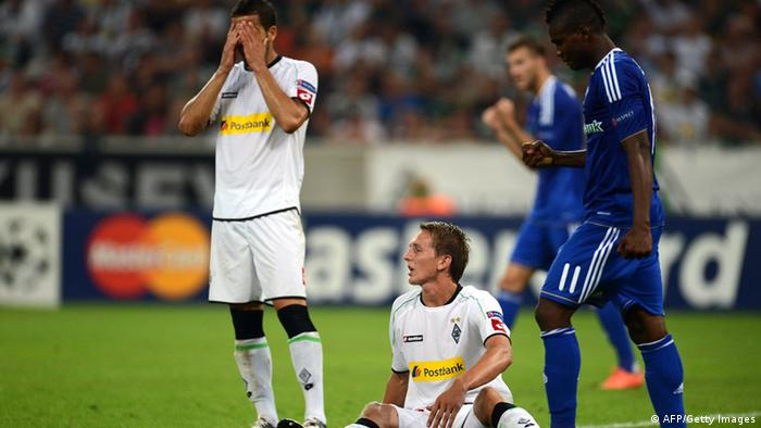 Moenchengladbach's defender Alvaro Dominguez (L) and Moenchengladbach's Dutch striker Luuk de Jong react during the Champions League Play-off round 1 st leg football match Borussia Moenchengladbach vs FC Dynamo Kyiv on August 21, 2012 in Moenchengladbach, western Germany . AFP PHOTO / PATRIK STOLLARZ (Photo credit should read PATRIK STOLLARZ/AFP/GettyImages)