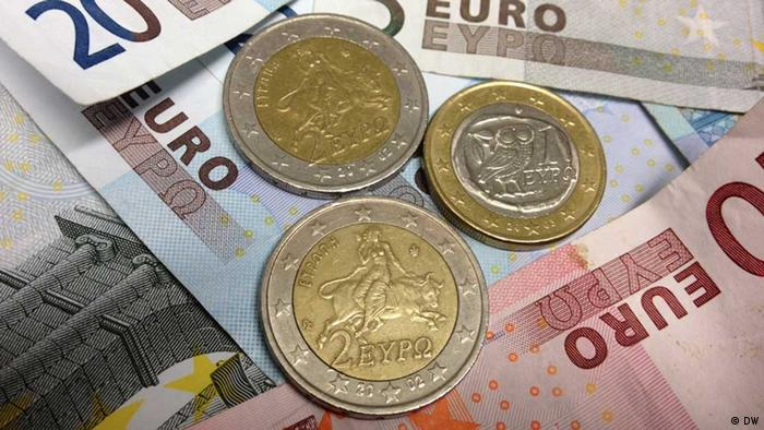 Greek euro coins resting on some euro banknotes