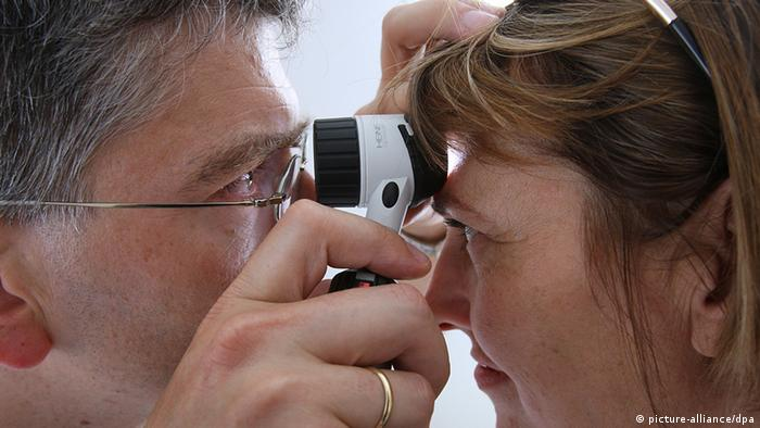 A doctor examines a patient's head