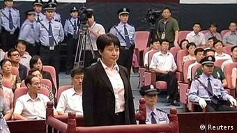 Gu Kailai (front, C), wife of ousted Chinese Communist Party Politburo member Bo Xilai, attends a trial in the court room at Hefei Intermediate People's Court in this file still image taken from video August 9, 2012. A Chinese court will deliver its verdict on August 20, 2012 against Gu Kailai on charges of killing a British businessman last year in a scandal that has shaken the Communist Party's transition to a new leadership. REUTERS/CCTV via Reuters TV/Files (CHINA - Tags: CRIME LAW POLITICS) FOR EDITORIAL USE ONLY. NOT FOR SALE FOR MARKETING OR ADVERTISING CAMPAIGNS. THIS IMAGE HAS BEEN SUPPLIED BY A THIRD PARTY. IT IS DISTRIBUTED, EXACTLY AS RECEIVED BY REUTERS, AS A SERVICE TO CLIENTS. CHINA OUT. NO COMMERCIAL OR EDITORIAL SALES IN CHINA