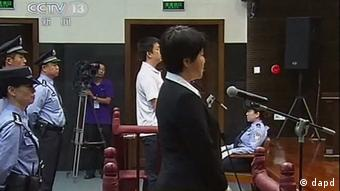 This video image taken from CCTV shows Gu Kailai, the wife of disgraced politician Bo Xilai, speaks in the dock at Hefei Intermediate People's Court in the eastern Chinese city of Hefei. Photo:CCTV via APTN/AP/dapd