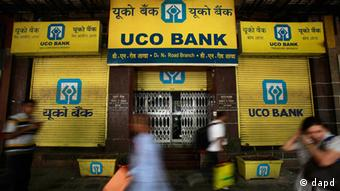 People walk outside a closed bank during a two-day strike in Mumbai, India, Wednesday, Aug. 22, 2012. (Photo: AP)