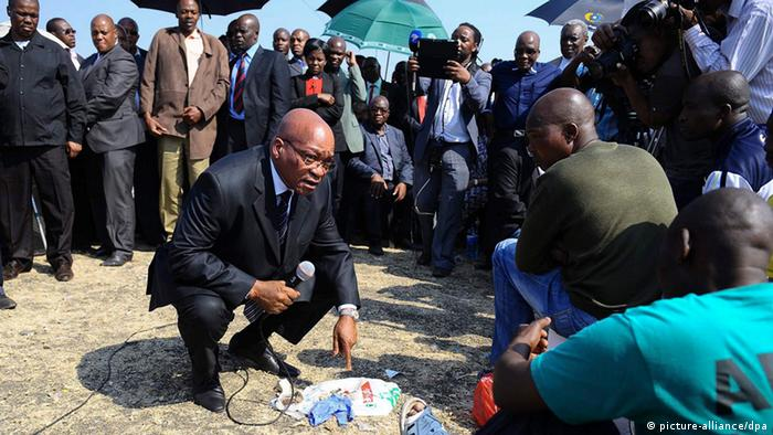 South African President Jacob Zuma speaks to the leadership of striking Lonmin mineworkers during his visit to Marikana