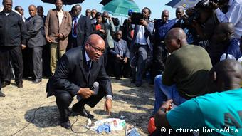 South African President Jacob Zuma (C) speaks to the leadership of striking Lonmin mineworkers during his visit to Marikana near Rustenburg, South Africa EPA/STR