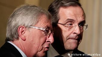 Greek Prime Minister Antonis Samaras (r) and Eurogroup president Jean-Claude Juncker (l) Copyright: EPA/ALKIS KONSTANTINIDIS