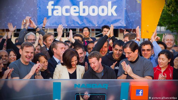 Mark Zuckerberg surrounded by a group of people (Photo: Facebook handout)