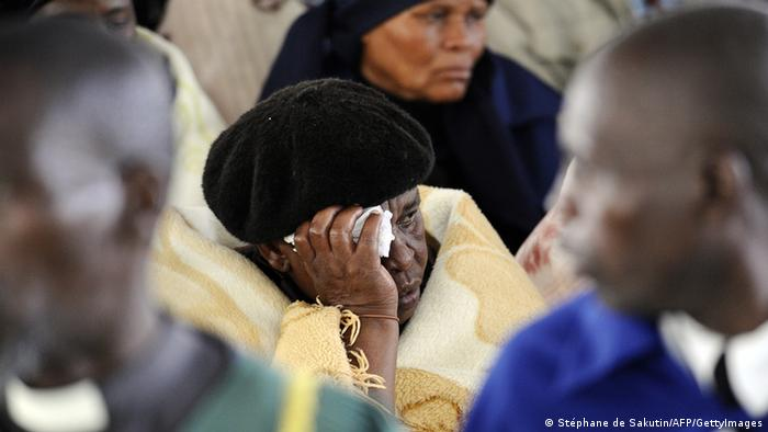 A woman mourns during a memorial service at Lonmin's Marikana mine