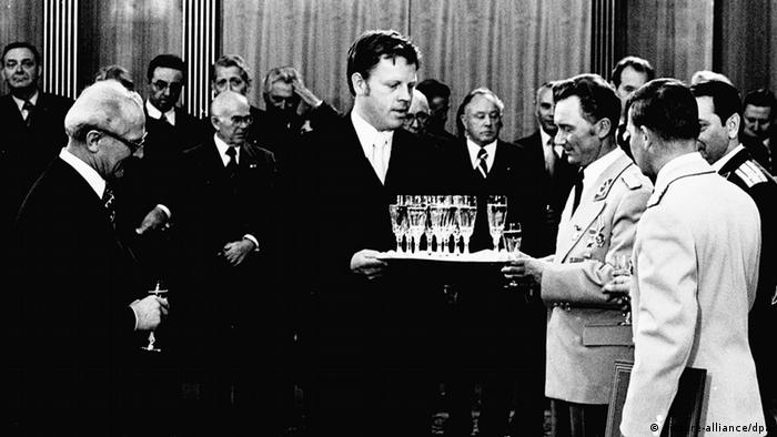 Sigmund Jähn, East Germany's first cosmonaut is given a glass of sparkling wine by Lothar Herzog in 1978.