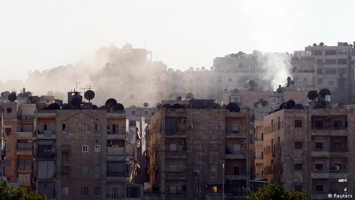 Smoke billows from buildings during clashes between Syrian rebels and pro-government forces in Aleppo