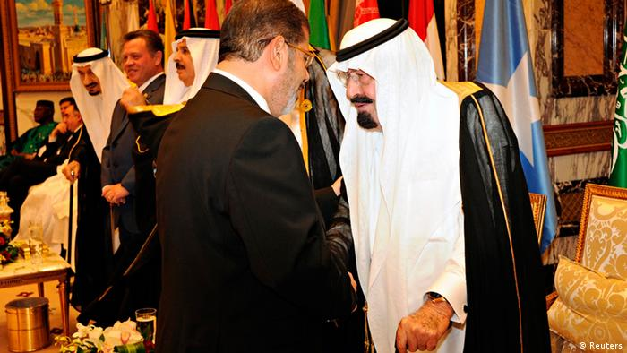 Saudi Arabia's King Abdullah speaks with Egypt's President Mohamed Mursi (Reuters)