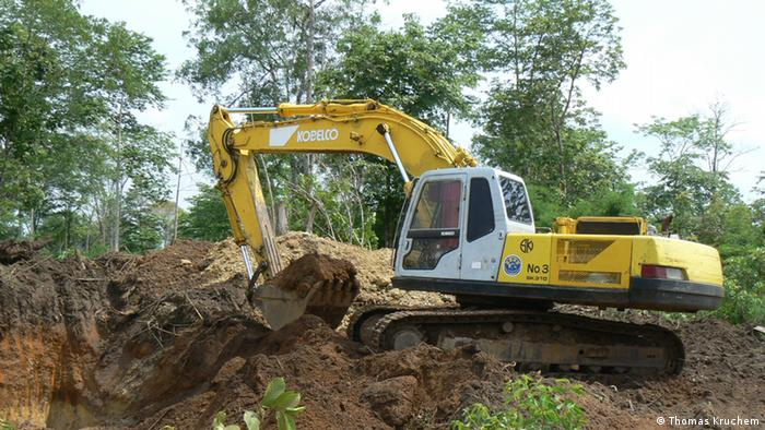 A bulldozer rips trees out of the ground in Cambodia Photo: Thomas Kruchem