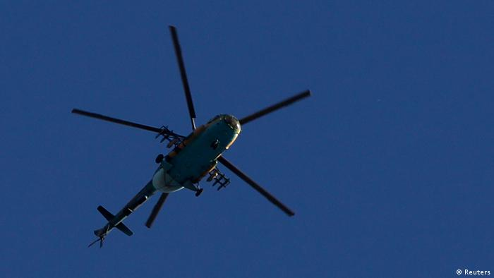 A Syrian Air Force helicopter prepares to fire a rocket REUTERS/Youssef Boudlal