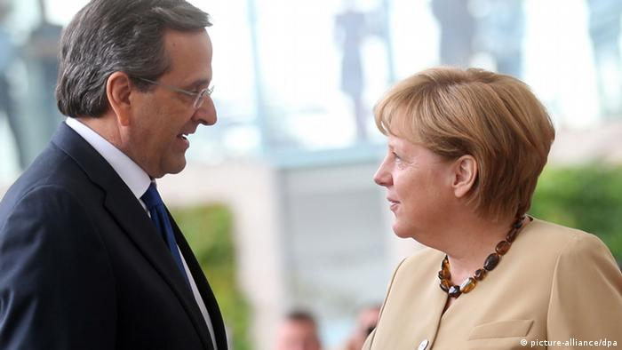 Samaras being received by Merkel