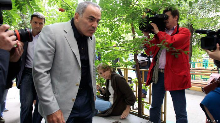 Former world chess champion and opposition leader Garry Kasparov arrives to attend a court hearing in Moscow