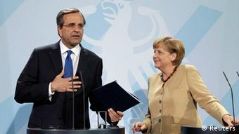 German Chancellor Merkel and Greek Prime Minister Samaras leave after news conference in Berlin (Photo: Reuters)