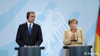 German Chancellor Angela Merkel (R) and Greek Prime Minister Antonis Samaras address a news conference after talks in Berlin, August 24, 2012.