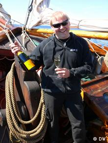 Diver Christian Ekström who discovered the haul of the world's oldest drinkable champagne found close to Aland in the Baltic Sea, pictured here aboard his boat