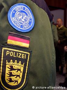 A sleeve showing logos of the UN and the German police (Photo: dpa)