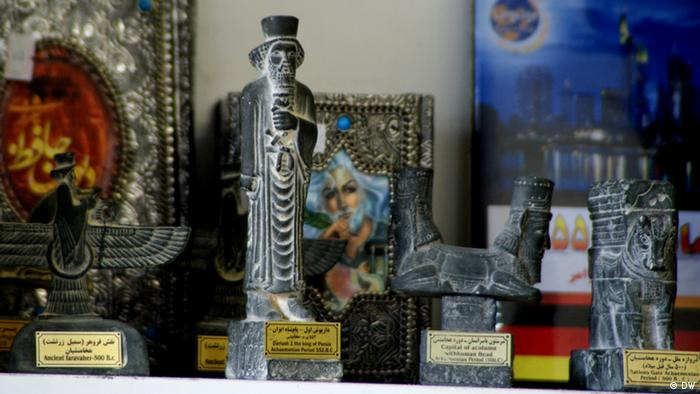 Iranian artworks on display in Mashallah Bahrampour's grocery store in Cologne
