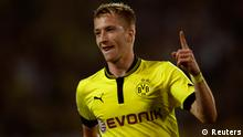 Borussia Dortmund's Marco Reus celebrates a goal against Werder Bremen during the German first division Bundesliga soccer match in Dortmund August 24, 2012. REUTERS/Ina Fassbender (GERMANY - Tags: SPORT SOCCER) DFL RULES TO LIMIT THE ONLINE USAGE DURING MATCH TIME TO 15 PICTURES PER GAME. IMAGE SEQUENCES TO SIMULATE VIDEO IS NOT ALLOWED AT ANY TIME. FOR FURTHER QUERIES PLEASE CONTACT DFL DIRECTLY AT + 49 69 650050