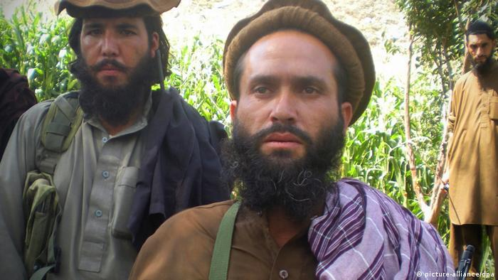 A picture dated 02 September 2011 shows Mullah Dadullah (C), a regional commander of Pakistani Taliban group Tehrik-e-Taliban Pakistan (Movement of Pakistani Taliban) talking to journalists at the Afghanistan-Pakistan border area of Kunar and Bajaur tribal region.