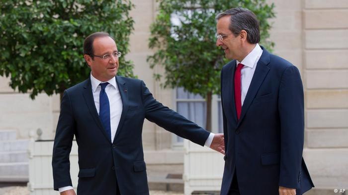 France's President Francois Hollande, left, welcomes Greece's Prime Minister Antonis Samaras at the Elysee Palace, Saturday, Aug. 25, 2012.