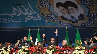 Iranian President Mahmoud Ahmadinejad (L) and Palestinian Hamas premier of Gaza, Ismail Haniya (R) flash the victory sign to the crowd during the 33rd anniversary of the Islamic revolution in Azadi (Freedom) Square in southwestern Tehran on February 11, 2012 in which Ahmadinejad said that Iran has broken the idol of the Holocaust underpinning the creation of the Israeli state and US hegemony. Photo by Vahdati Isna/ParsPix/ABACAPRESS.COM # 308168_009