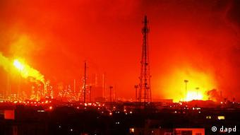 Fires light up the night sky in Amuay, Venezuela after an explosion spread over the complex of one of the country's largest oil refineries
