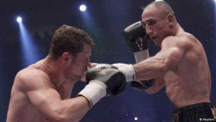 Germany's new WBO Super Middleweight World Champion Arthur Abraham (R) lands a punch on his compatriot Robert Stieglitz during their fight in Berlin August 25