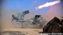 (FILE) A file picture dated 12 October 2001 shows a BM-21 missile launcher of Afghan opposition fighters shell Taliban positions in the province of Kapiso, some 45 km from Kabul, Afghanistan. The tenth anniversary of the invasion of Afghanistan is marked on 07 October 2011. On 07 October 2001 the United States of America launched Operation Enduring Freedom in Afghanistan in response to the terrorist attacks on the United States of 09 September 2001. The stated goal was to dismantle the Al Qaeda terrorist organization and end its use of Afghanistan as a base. The military campaign also aimed to remove the ruling Taliban regime from power and create a viable democratic state. EPA/SERGEI ILNITSKY (zu dpa-Themenpaket Zehnter Jahrestag des Beginns des Afghanistan-Kriegs) +++(c) dpa - Bildfunk+++